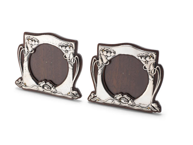 A pair of Art Noveau silver photograph frames one by Moore & Clark and one by Thomas Walker, Birmingham 1900-02