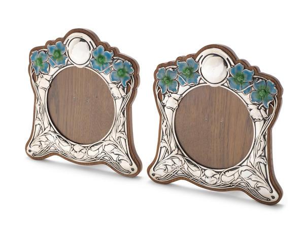 A pair of Edwardian Art Nouveau silver and enamelled photograph frames by E. Mander & Son, Birmingham 1902