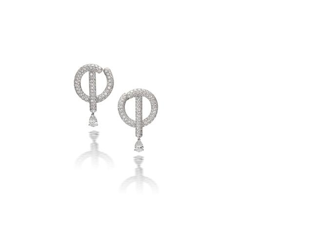 A pair of diamond earrings, by Chanel