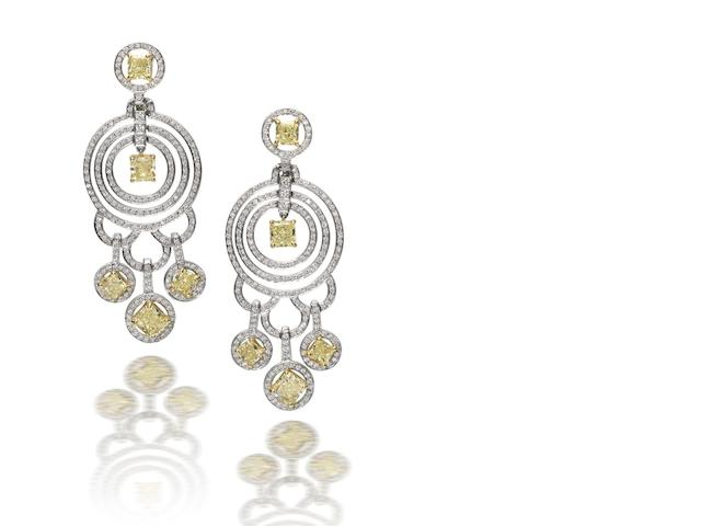 A pair of fancy coloured diamond and diamond pendent earrings, by Graff