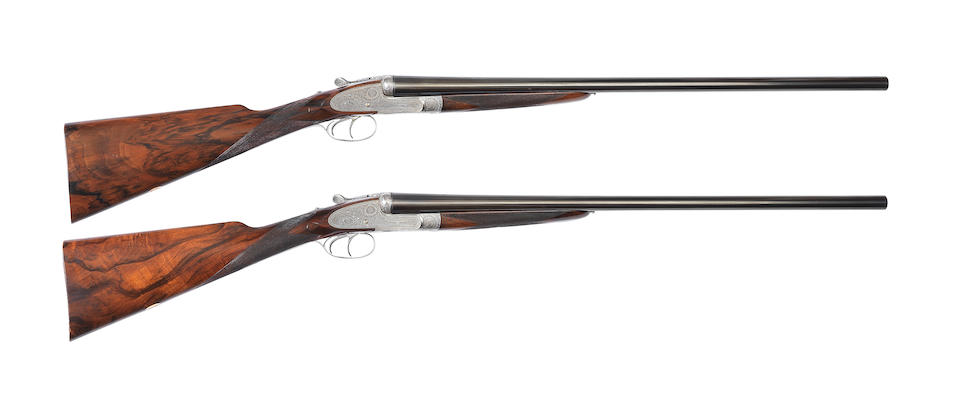 A fine pair of 12-bore self-opening sidelock ejector guns by Holland & Holland, no. 33572/3 In a brass-mounted leather case with Holland & Holland trade label and later canvas cover