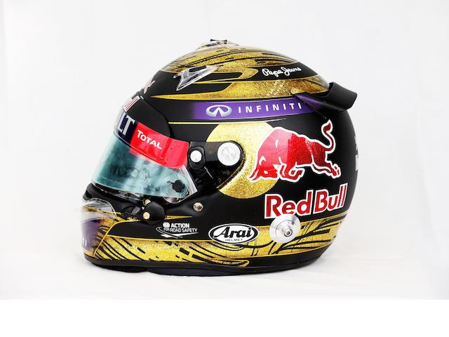A signed Sebastian Vettel helmet by Arai, used during the race weekend at the German Grand Prix, Nurburgring, 2013,