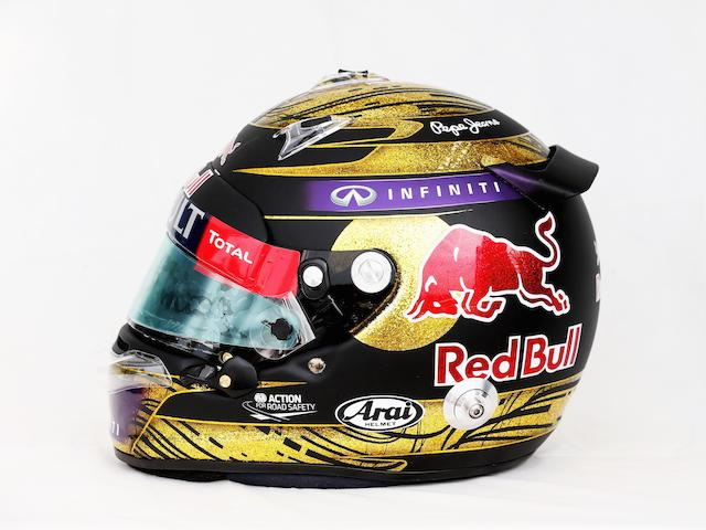 A signed Sebastian Vettel helmet by Arai, used during the race weekend at the German Grand Prix, Nurburgring, 2013,