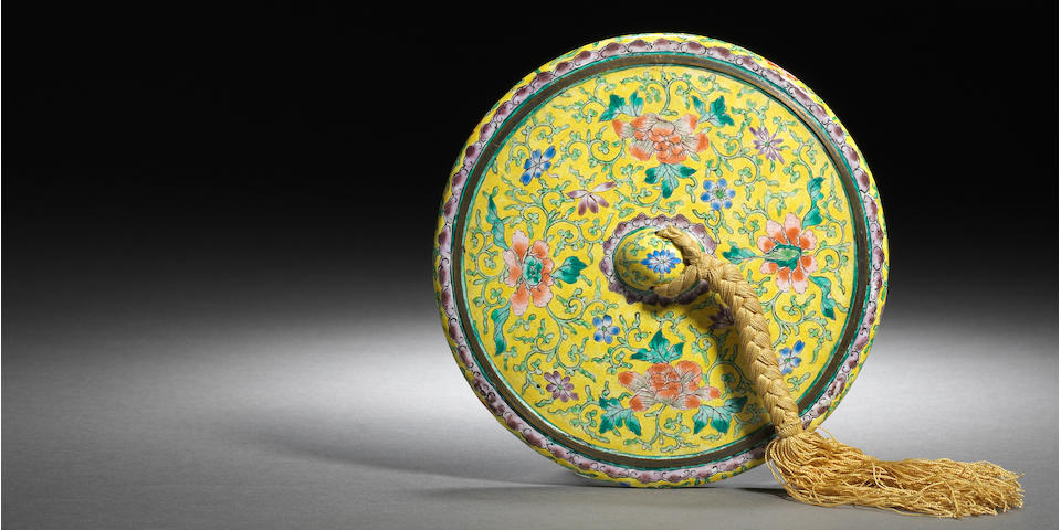 An Imperial Canton enamel yellow-ground mirror Late Qianlong/Jiaqing