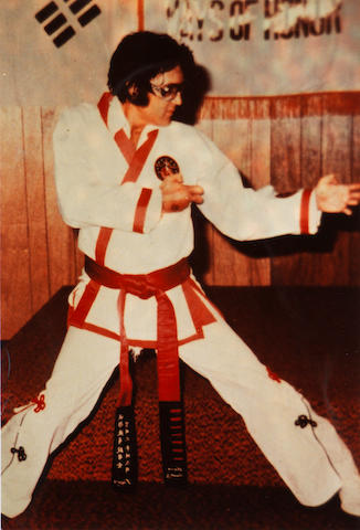 Elvis Presley: A collection of eight photographs of Elvis Presley in various karate poses,
