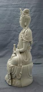 A blanc-de-chine figure of Guanyin
