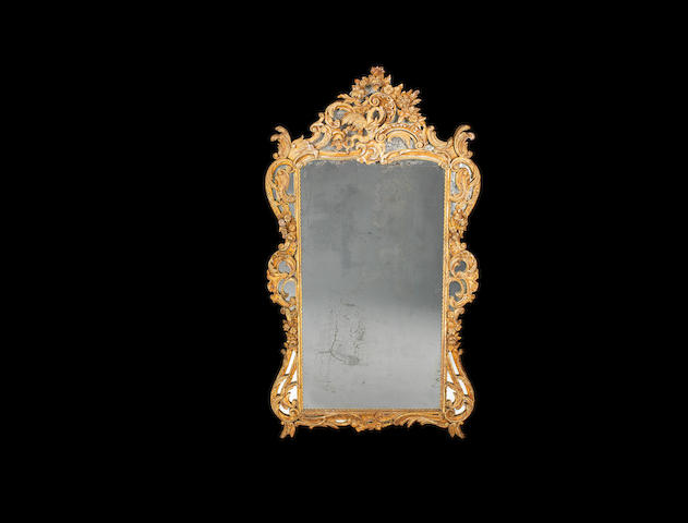 A large 19th century Rococo style giltwood marginal mirror
