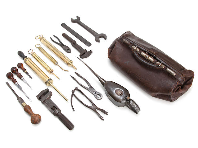 A tool-bag and assorted Veteran tools,