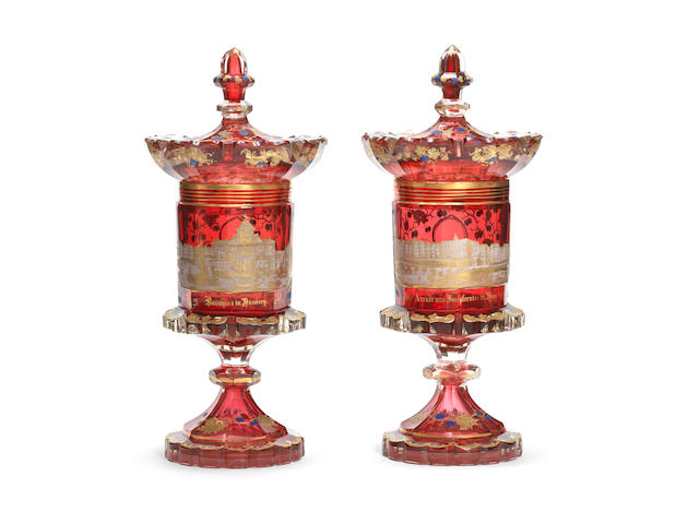 A pair of Bohemian enamelled topographical goblets and covers, circa 1835-40