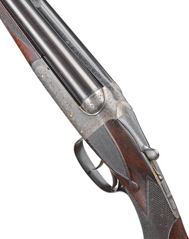 A fine .303 boxlock ejector rifle by Westley Richards, no. 15686 In a Westley Richards brass-mounted oak and leather case