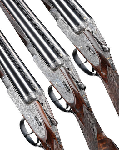 A matched trio of Best Quality 12-bore 'Royal Brevis' self-opening sidelock ejector guns by Holland & Holland, no. 33302/3 and 36589 In a triple motor-case with Holland & Holland trade label (handle partially detached)