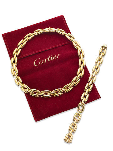 A collar and bracelet suite, by Cartier