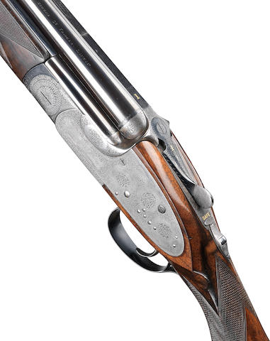 A fine 12-bore (2¾in) single-trigger over-and-under sidelock ejector gun by J. Woodward & Sons, no. 6528 In a brass-mounted leather case with canvas cover