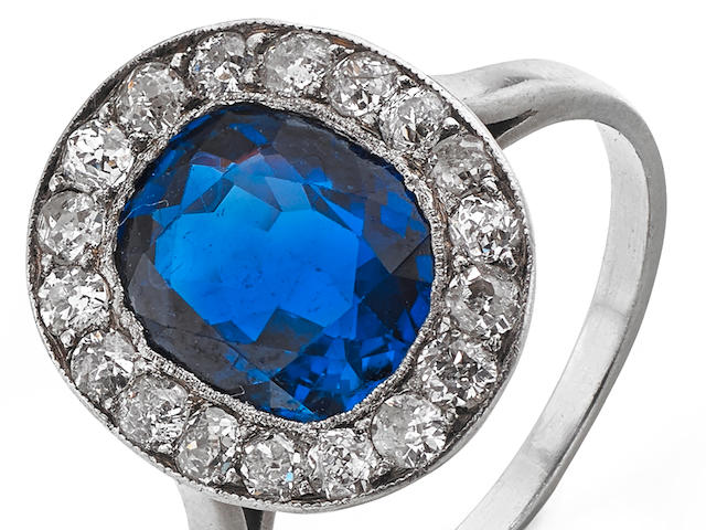 An early 20th century sapphire and diamond cluster ring