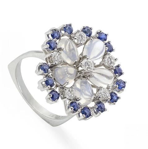 A moonstone, sapphire and diamond cluster ring, 1970s