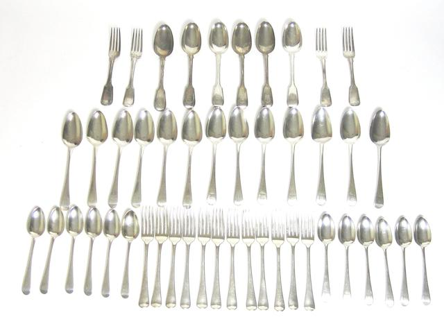 A set of George III matched silver flatware various makers and dates