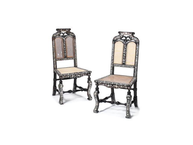 A pair of 18th century Indo-Portuguese mother-of-pearl inlaid, padouk and ebony side chairs