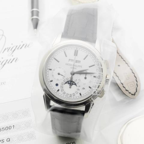 Patek Philippe. A very fine and very rare white gold perpetual calendar wristwatch with phases of the moon, day and night indication, with additional case back, still factory sealed  Ref:5270G-001, Case No.4565001, Movement No.5643371, Sold 6th September 2012