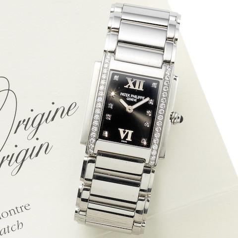 Patek Philippe. A lady's diamond set stainless steel quartz bracelet watch  Twenty-Four, Ref:4920/10A-001, Case No.4184826, Movement No.3294056, Sold 5th July 2002