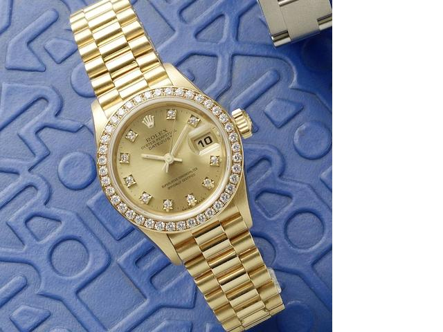 Rolex. A lady's 18ct gold diamond set automatic calendar bracelet watch Datejust, Ref:69138, Serial No.N49****, Circa 1991