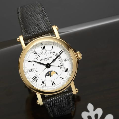 Patek Philippe. A fine and rare 18ct gold perpetual calendar wristwatch with phases of moon Ref:5059, Case No. 4292518, Movement No. 3236747, Circa 2003