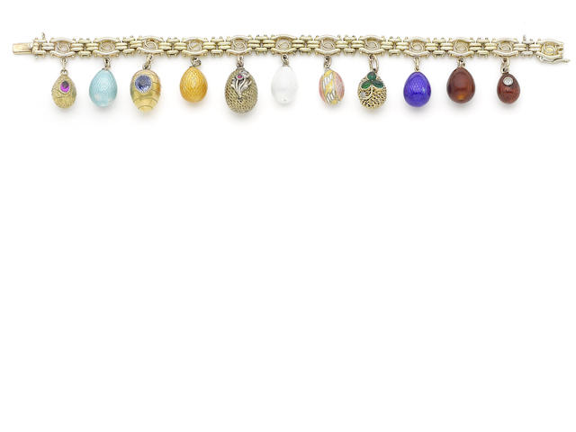 A gold bracelet with miniature egg pendants,