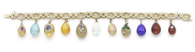 A gold bracelet with miniature egg pendants,