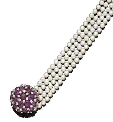 A four-strand pearl necklace with ruby and diamond clasp