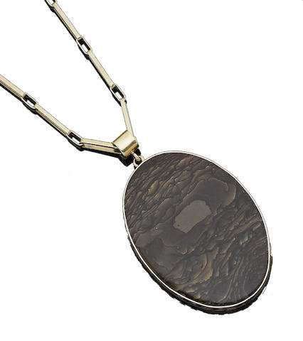 A petrified wood pendant necklace, by John Rørvig
