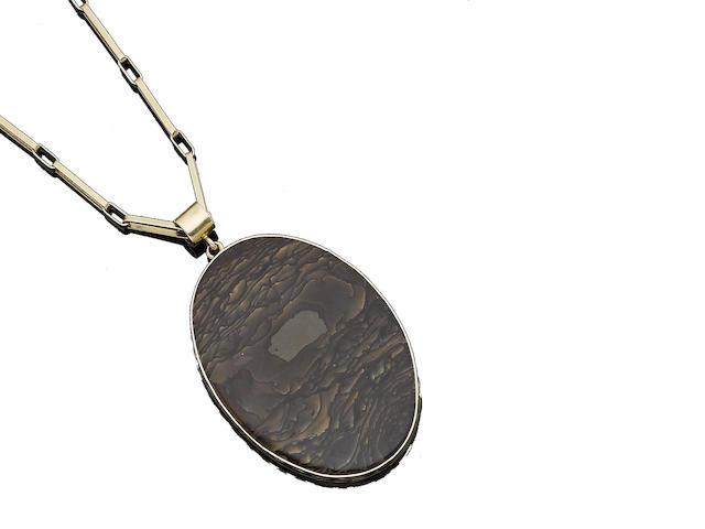 A petrified wood pendant necklace, by John Rørvig