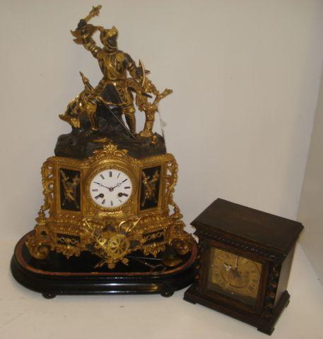 An ornate French bronzed and gilt metal mantel clock, 2nd half 19th Century, decorated with military trophies and surmounted by a figure in armour, the white enamel dial signed 'Azur a Paris', further signed on the backplate, the 8 day movement with outside countwheel striking on a bell, 52cm, ebonised plinth and an oak cased mantel timepiece, in 17th Century style, by Mappin & Webb. (2)
