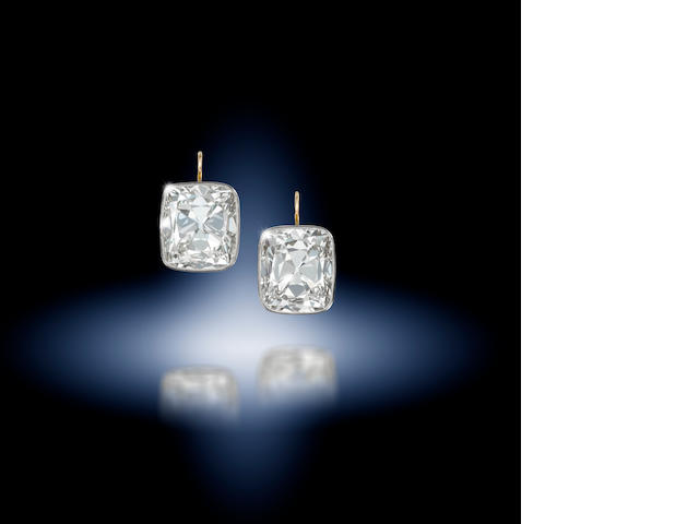 A magnificent pair of diamond single-stone earrings