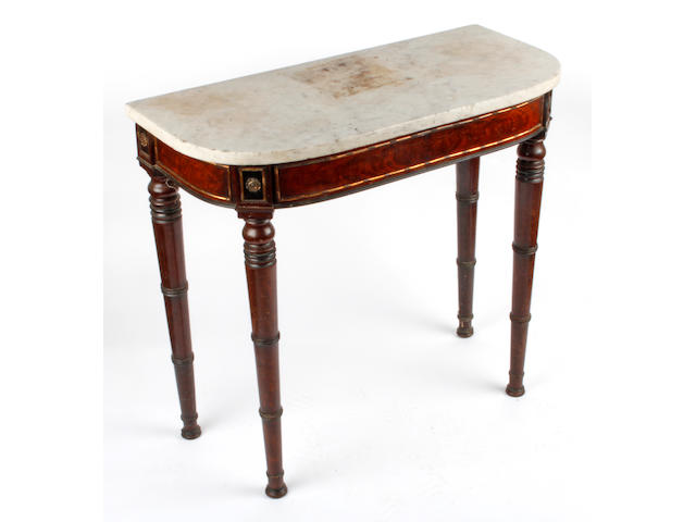 A late 19th Century gilt metal mounted mahogany side table, with white marble top, on ring turned legs, 79cm.