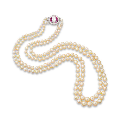 A pearl necklace with ruby and diamond clasp,
