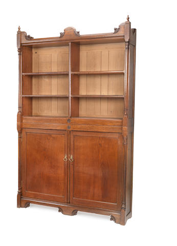 Three similar mid Victorian Gothic revival oak low bookcases later converted into a two-tier bookcase and a low open bookcase by Gillows