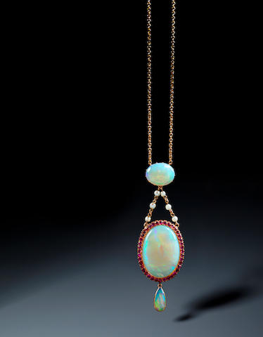 An opal and ruby cluster pendant
