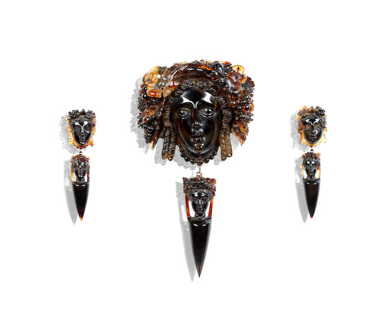 A Victorian carved tortoishell pendant/brooch and earpendants suite, circa 1860s/70s