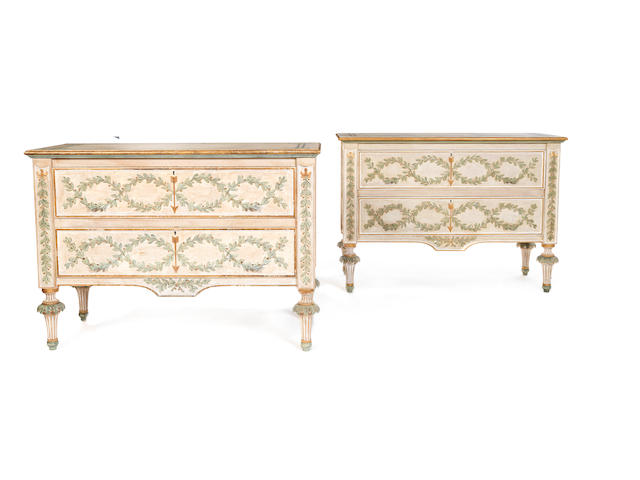 A pair of Italian painted and parcel gilt commodes in the late 18th century Neoclassical style