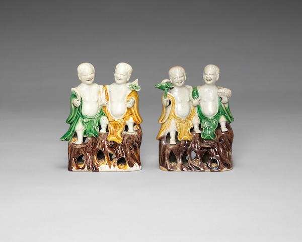 A pair of famille verte biscuit models of the He He Erxian Kangxi