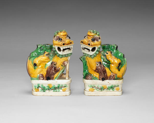 A pair of famille verte biscuit joss stick holders Kangxi