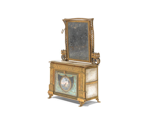 An early 19th Century French 'Palais Royal' pressed gilt brass and mother of pearl veneered novelty jewellery casket