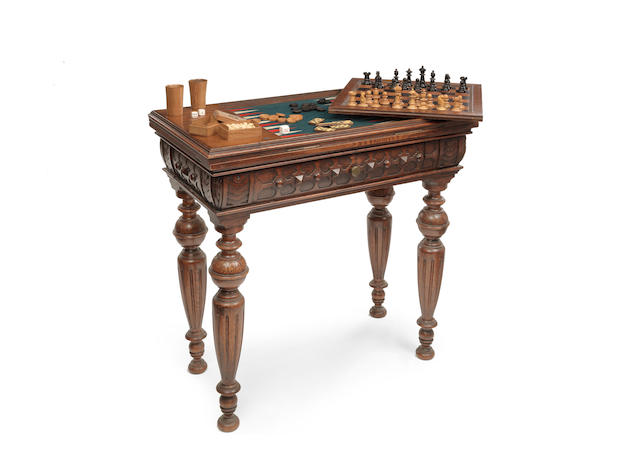An early Victorian Elizabethan revival oak games table/compendium in the manner of Bridgens