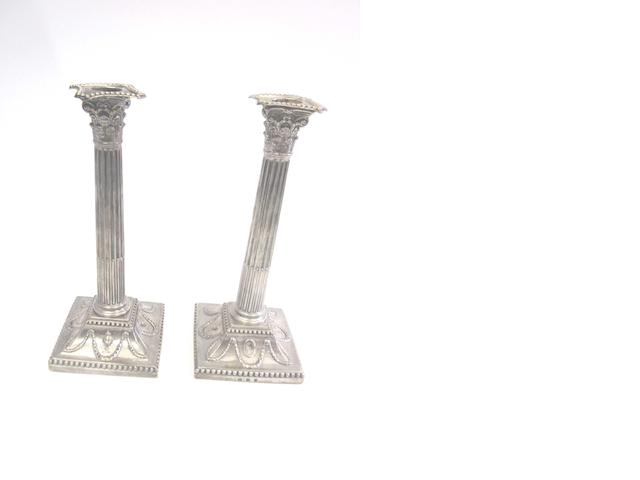 A pair of George III silver Corinthian column candlesticks by Winter, Parsons & Hall, Sheffield 1777 (2)