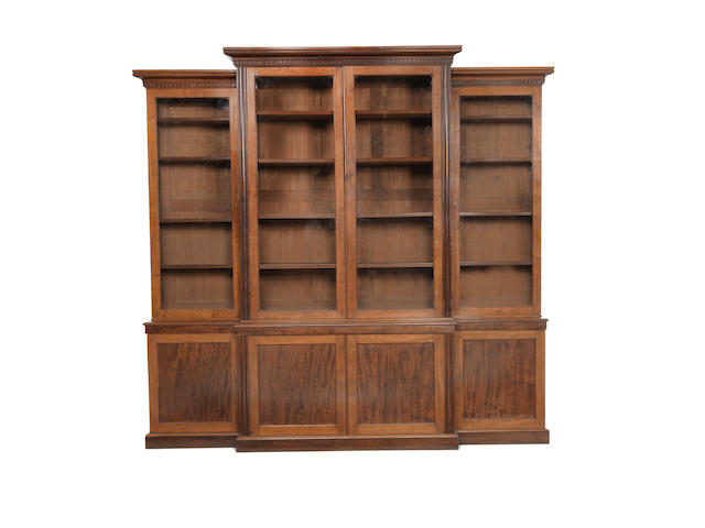 An early Victorian mahogany breakfront bookcase  by Holland & Sons