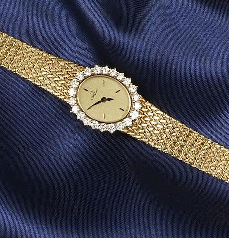 Omega: A lady's 18ct gold and diamond set wristwatch