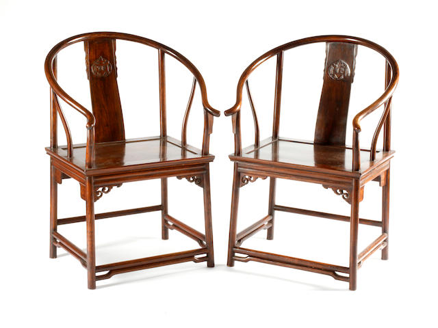 A pair of Chinese hardwood horseshoe-back chairs 20th Century