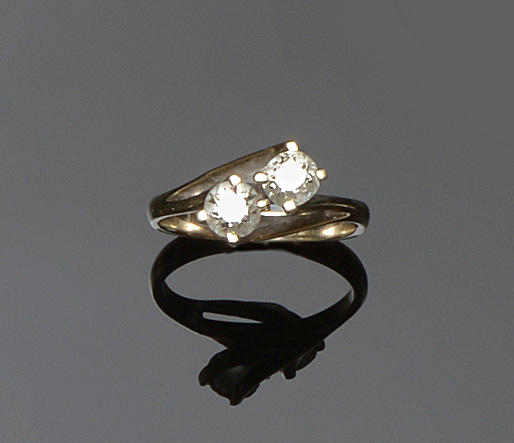 A two stone diamond crossover ring