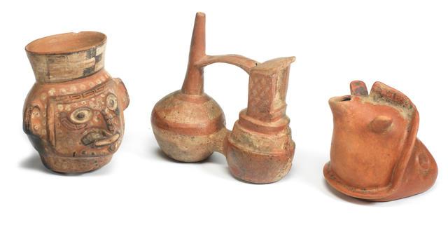 A Chimu bridge-spout vessel, a Colima pouring vessel and a Moche urn Peru and Mexico. 3