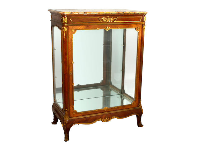A late 19th Century Louis XVI style kingwood and gilt metal mounted glazed display display cabinet