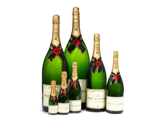 A graduated display set of seven Moet & Chandon champagne bottles in varying sizes